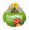 Camping tent mushrooms green grass sun mountain behind Royalty Free Stock Image