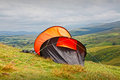 Camping tent in an orange on hillside Royalty Free Stock Photography