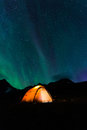 Camping under northern lights aurora borealis on a trekking tour in lapland in sweden Royalty Free Stock Image
