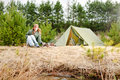 Camping woman tent cook food fire nature Stock Photography