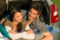 Camping young couple lying car summer sunset Royalty Free Stock Photo