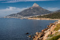Camps bay and lions head cape town south africa a set of rocks at the shore at the first plane in the mountain in the horizon Stock Photos