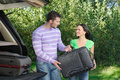 Can� wait our journey start an attractive young couple packing the luggage into the trunk Stock Images