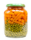 Can of carrots and peas isolated on white Royalty Free Stock Photo