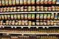 Can food in supermarket organized on shelves a big Royalty Free Stock Images