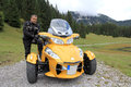 The can am spyder with yellow in mountains Stock Image