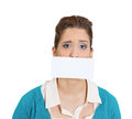 Can t speak closeup portrait of young moral afraid female with envelope covering mouth no evil concept isolated on white Royalty Free Stock Image