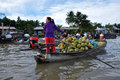 Can tho feb unidentified vietnamese people selling coconut from boat at the floating market in can tho vietnam on feb with Stock Photo