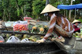 Can tho feb unidentified vietnamese people selling pineapple from boat at the floating market in can tho vietnam on feb with Stock Photography