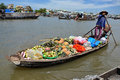 Can tho feb unidentified vietnamese vendor selling goods from boat at the floating market in can tho vietnam on feb with hundreds Royalty Free Stock Photos