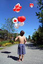 Canada boy with Birthday balloons. Royalty Free Stock Photo