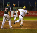 Canada games baseball men runner speed base manitoba s chad millar rounds third against new brunswick in s at the august in Stock Photos