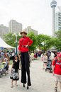 Canada s day toronto july a man on stilts poses with the public during celebrations as seen on july in toronto Stock Photography