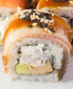 Canada sushi roll with sesame on white plate Royalty Free Stock Image