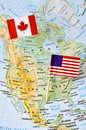 Canada and USA flag pin on map Royalty Free Stock Photo