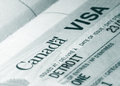 Canada visa close up shot of stamp on passport Royalty Free Stock Photo