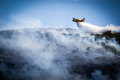 Canadair in action extinguishes a fire on island vis Stock Photography