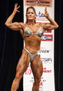 Canadian athlete laura boisacq strikes a front double biceps pose at the ifbb new york women s pro physique championships at the Royalty Free Stock Images