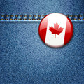 Canadian Flag Badge on Denim Fabric Texture Royalty Free Stock Photography