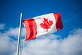 Canadian flag flying in the breeze Royalty Free Stock Photo