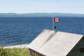 Canadian flag in high wind located forilon national park near gaspe quebec canada gaspe is known for its winds Royalty Free Stock Images