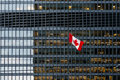 Canadian flag and modern office building in downtown Toronto Royalty Free Stock Photo