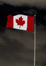 Canadian Flag over menacing sky Royalty Free Stock Photo