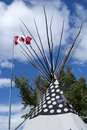 Canadian flag over top of teepee. Royalty Free Stock Photo