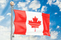 Canadian flag waving in blue cloudy sky, 3D rendering