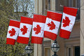 Canadian national flags five hanging from embassy building in trafalgar square london england Royalty Free Stock Photos