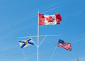 Canadian nova scotia and american flags the usa flying in the wind Stock Photos