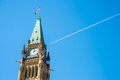 Canadian Parliament Peace tower in Ottawa, with a plane over the Royalty Free Stock Photo