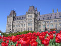 Canadian parliament with red tulips around Stock Photography