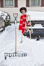 Canadian skeleton a shoveling his car out of the snow Stock Image
