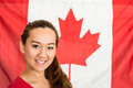 Canadian sportsfan beautiful asian woman a sports fan standing in front of a flag Royalty Free Stock Images