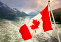Canadien flag in front of inlet canadian indian arm vancouver Royalty Free Stock Photos