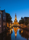 Canal in alkmaar netherlands at dusk city center of weighing tower dutch waagtoren can be seen reflected the water Stock Images