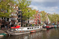 Canal in amsterdam picturesque brouwersgracht with barge houseboats and historic apartment buildings netherlands Stock Photography