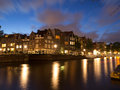 Canal in amsterdam at sunset keizersgracht with housefront Royalty Free Stock Photo