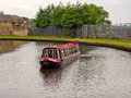 Canal barge negotiating the locks on leeds liverpool lancashire uk Stock Photography
