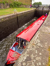 Canal barge negotiating the locks on leeds liverpool lancashire uk Royalty Free Stock Photography