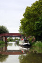 Canal boat canals in united kingdom with boats bridges and vegetation Stock Photography