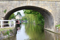 Canal boat canals in united kingdom with boats bridges and vegetation Stock Photos