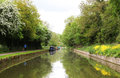 Canal boat canals in united kingdom with boats bridges and vegetation Royalty Free Stock Images