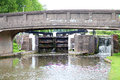 Canal boat lock and bridge in united kingdom Stock Photos