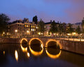 Canal with bridge in amsterdam at night keizersgracht Stock Photography
