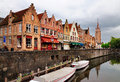 Canal bruges belgium tower background belongs to church our lady Royalty Free Stock Photography