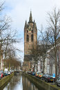 Canal and church tower in Delft, Royalty Free Stock Photo