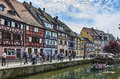 Canal in colmar france april rd tourists walking on a traditional street near a alsace france Stock Photos