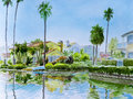Canal corner tall palm trees grace a on a in venice ca in a watercolor painting Royalty Free Stock Photography